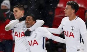 Tottenham's Kyle Walker-Peters celebrates scoring their sixth goal with Erik Lamela and Dele Alli.