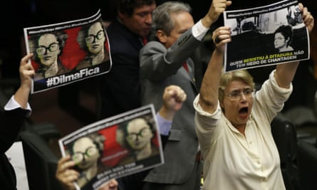 """Lawmakers who support President Dilma Rousseff hold up pictures of the leader when she was a political prisoner, which read in Portuguese: """"Dilma stay."""""""