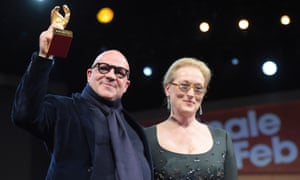 Director Gianfranco Rosi  holds his Golden Bear for best film next to US actor and jury president Meryl Streep