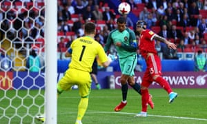 Cristiano Ronaldo heads the ball beyond Igor Akinfeev to score Portugal's winning goal after just eight minutes.