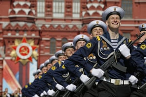 Servicemen march in formation for the Victory Day parade in Red Square, Moscow