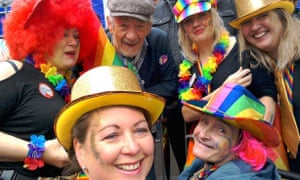 Staff and Belong Wigan resident Jane Chadbond with Sir Ian McKellan at the first ever Wigan Pride event.