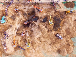 Firefighters and more than 10 excavators work to save a 20-month-old boy who got stuck approx 10 meters deep in a disused well, Xi'an, China