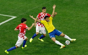 Brazil's Fred falls after making contact with Croatia's Dejan Lovren during a World Cup group match in Brazil, in 2014.