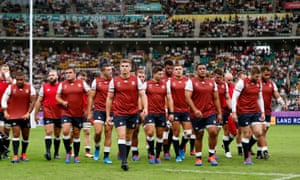 Owen Farrell and the England players leave the pitch after the warm up.