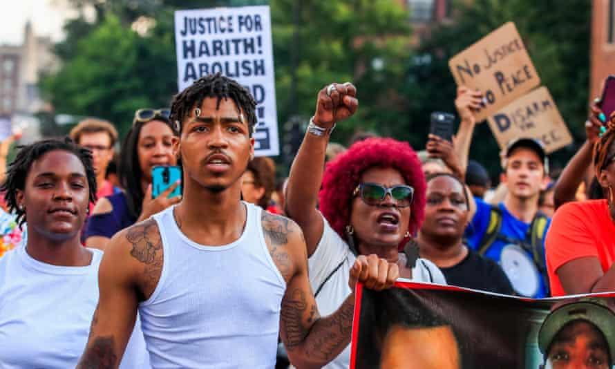 People protest against the shooting of Harith Augustus by a Chicago police officer. A new art exhibit examines the case from a different perspective.