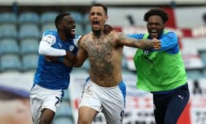 Jonson Clarke-Harris celebrates scoring the Posh' promotion winning goal.