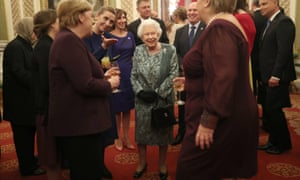 The Queen talks to guests during a reception at Buckingham Palace to mark 70 years of the Nato alliance