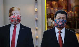 A view shows cardboard cutouts displaying images of US President Donald Trump and Chinese President Xi Jinping wearing face masks near a gift shop in Moscow, Russia.