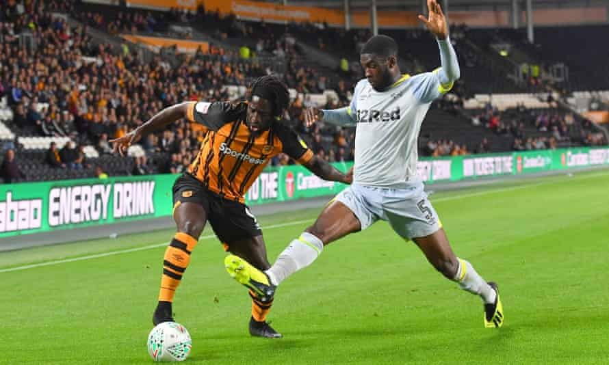 Hull City forward Nouha Dicko is challenged by Derby County's Fikayd Tomori in front of a noticeably sparse crowd at the KCom Stadium