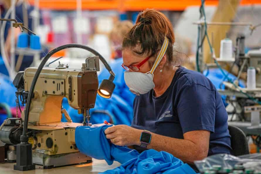 A worker makes scrubs for frontline NHS staff in O'Neills sportswear factory in Strabane in Northern Ireland