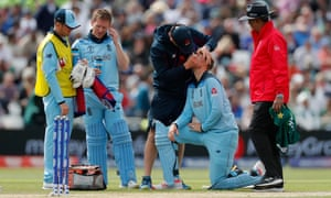 Joe Root of England receives treatment to his eye.
