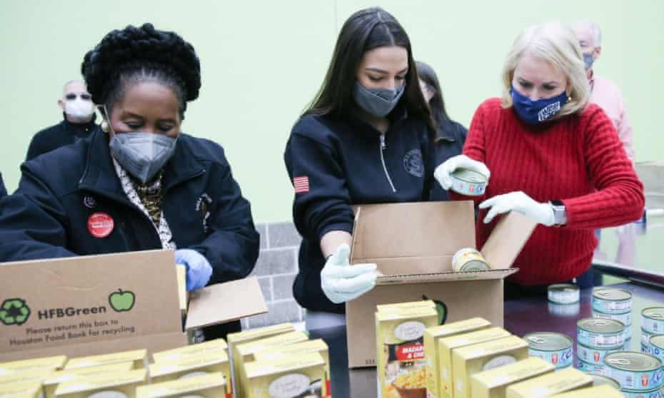 Democratic congresswomen Sheila Jackson Lee, Hilary Ocasio-Cortez and Sylvia Garcia each distribute food at the Houston Food Bank.