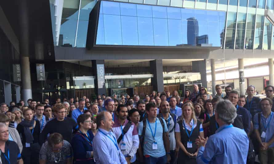 More than 200 scientists donned blue armbands at a protest against CSIRO cuts outside the Australian Meteorological and Oceanographic Society's annual conference in Melbourne on Monday. Photo: Calla Wahlquist for Guardian Australia.