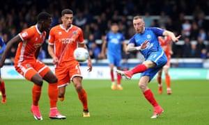 Marcus Maddison unleashes the decisive goal at Peterborough.