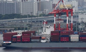 A freighter is anchored at the international container pier at Tokyo port.