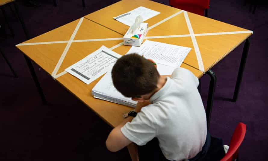 A child studies on a table set up for physical distancing in Worcester.