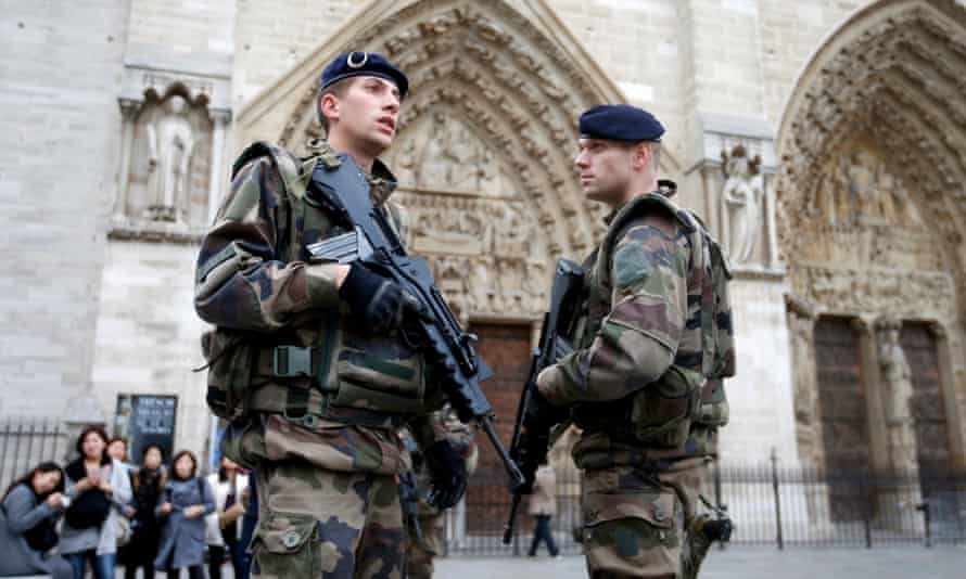 Soldiers stand guard in front of the Notre Dame cathedral in Paris.