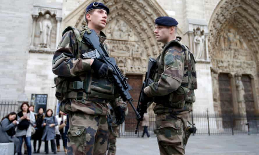 Soldiers patrol in front of the Notre Dame Cathedral in Paris after last Friday's attacks.