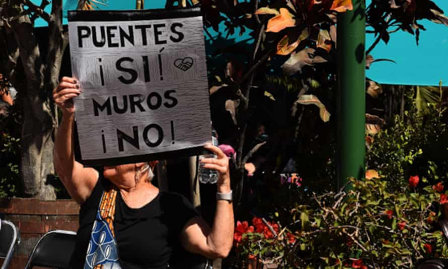 A woman holds a sign that reads: 'Bridges yes, walls no' during the Women's March in Ajijic, a town in Jalisco state, Mexico.