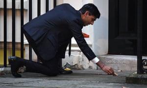 Rishi Sunak lights oil lamps for Diwali outside his Downing Street residence.