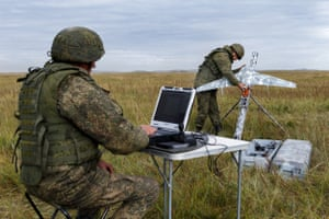 A serviceman holds an Eleron-3 reconnaissance unmanned aerial vehicle