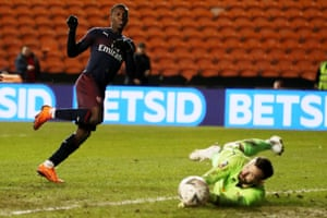 Blackpool goalkeeper Mark Howard saves from Arsenal's Edward Nketiah.