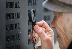 Maria Orlova looks for her father on the Wall of Memory  at the Katyn memorial in Smolensk, Russia