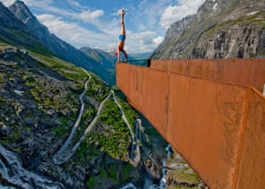 Eskil Rønningsbakken, who describes himself as an 'extreme artist', performs one of a series of stunts at a mountain lookout point in Trollstigen, Norway.