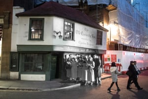 King's College students sing carols outside the Old Curiosity Shop, as immortalised by Charles Dickens, on Portsmouth Street on 12 December 1956. The store was photographed again on 24 November 2014