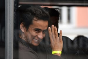A refugee waves after arriving in Munich