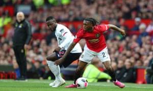 Aaron Wan-Bissaka of Manchester United gets the better of Liverpool's Divock Origi.