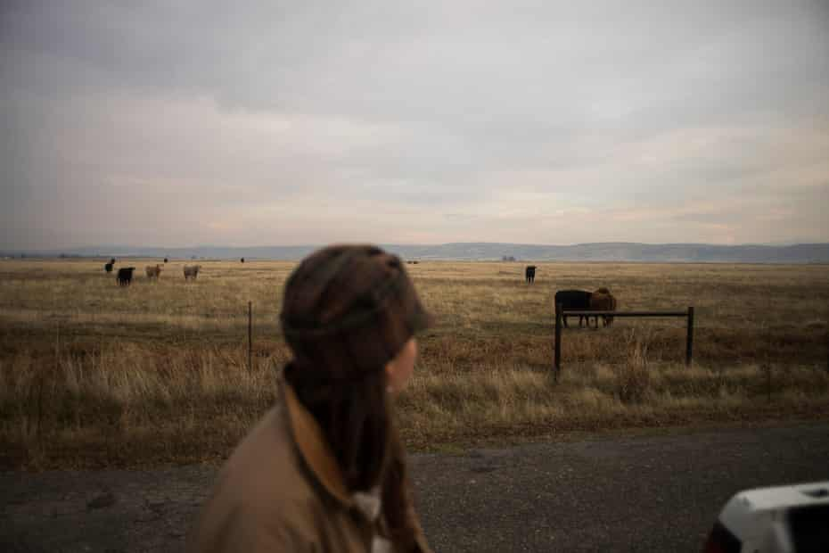 Breanna Owens looks over the livestock at her ranch in Los Molinos, California.