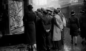 A small crowd in Fleet Street, London, looking at a map of Abyssinia in October 1935.