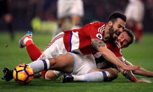 Gareth McAuley brings down Middlesbrough's Alvaro Negredo.