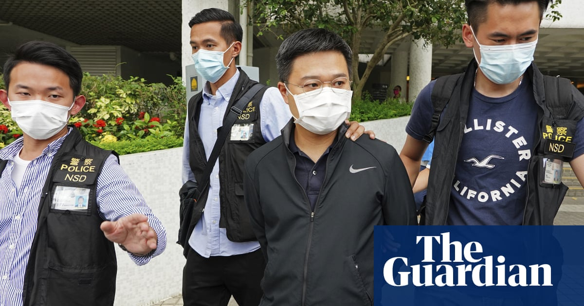 Hong Kong police arrest editor of Apple Daily newspaper – video