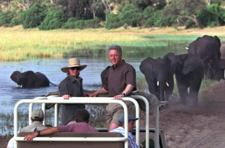 Then first lady Hillary Clinton and President Bill Clinton watch as a herd of elephants drink on the banks of the Chobe River in Chobe National Park in 1998.