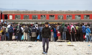 TOPSHOTS Migrants and refugees board a train after crossing the Macedonian-Greek border near Gevgelija.