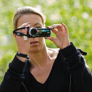 Woman using a digital movie camera