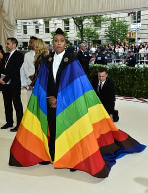 She declared she didn't want to blend in and there was no doubt writer and actor Lena Waithe stood out on the Met Gala red carpet by wearing a suit and LGBTQ pride-flag cape designed by Carolina Herrera.