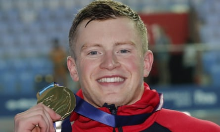 Britain's Adam Peaty poses with his gold medal following the men's 50m breaststroke final at the world swimming championships.