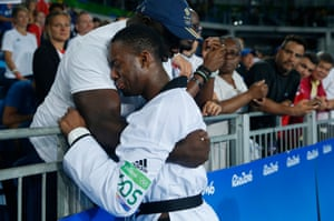 Lutalo Muhammed of Great Britain cries into his father's arms after he lost his gold medal tae-kwondo bout in the last second