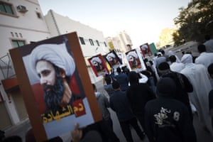 Bahraini protesters hold placards bearing portraits of prominent Shia cleric Nimr al-Nimr during protests against his execution by Saudi authorities.