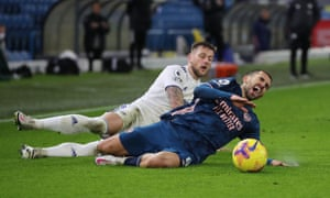 Dani Ceballos goes down under a challenge from Leeds' Liam Cooper.