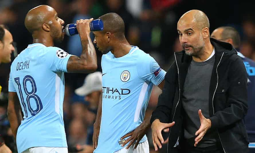 Fabian Delph and the rest of Manchester City's defenders are encouraged to play out from the back under Pep Guardiola, right.