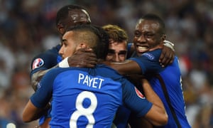 Antoine Griezmann is congratulated by his teammates.