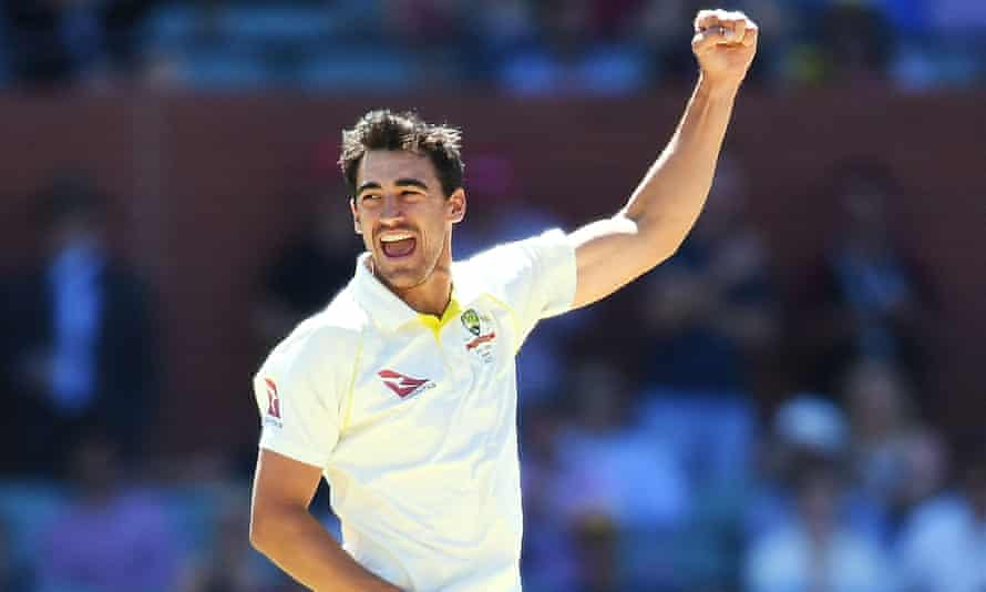 Mitchell Starc of Australia celebrates after taking the wicket of Craig Overton in the second Ashes test at Adelaide.