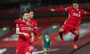 Liverpool's Diogo Jota (left) celebrates scoring their second goal with Roberto Firmino (right) and Trent Alexander-Arnold.