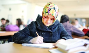 Muslim girl studying in a library