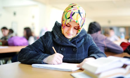 Muslim girl studying in library 2014.